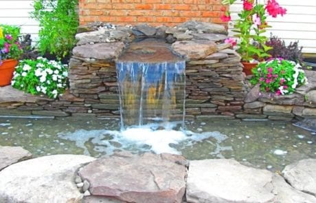 Small waterfall spilling into basin