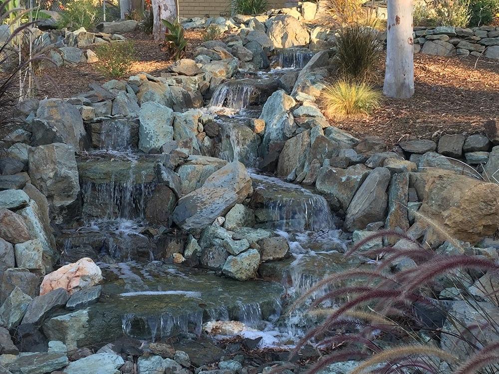 Small waterfall tumbling into stream